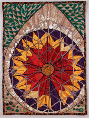 Gaudi Gaillardia, a knitted, embellished quilt by Suzann Thompson
