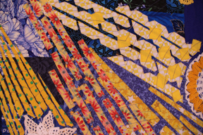 Detail of art quilt Constant Comets, by Suzann Thompson, which will be in the Celebrate Doilies exhibit, July-September 2017