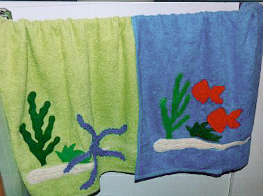 crocheted starfish, knitted fish on towels