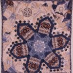 Art quilt Winter Blues, by Suzann Thompson, features a doily and buttons. It will be in the Celebrate Doilies exhibit, July-September 2017