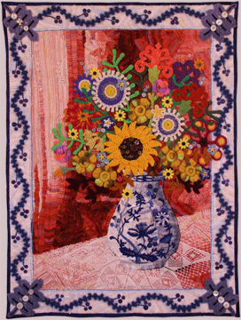 Art quilt Winterling, by Suzann Thompson, features crocheted flowers, doily, and many buttons. See it in the Celebrate Doilies exhibit, July-September 2017