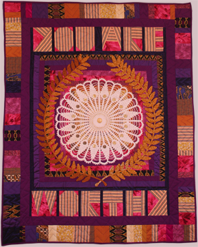 Art quilt A Worthy Accomplishment by Suzann Thompson will travel with the Sacred Threads exhibit 2017-2019
